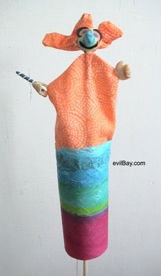 paper tube, tissue paper, glue, fabric, sculpy clay, shishkabob stick