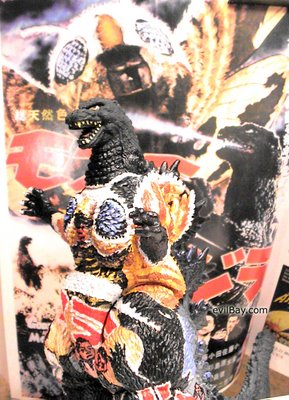 Movie poster painted onto Godzilla toy